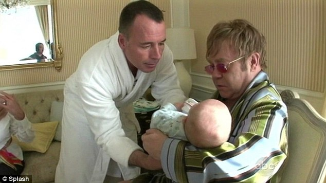 Doting dads: The couple welcomed first son Zachary into the world in December 2010