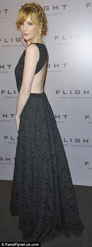 Showing some flesh: Kelly wore a dramatic black dress with cut-out back