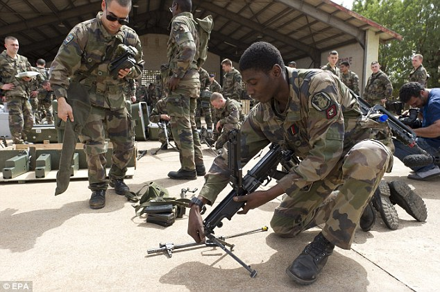 Weapons: French soldiers from 2nd RIMA 'Marsouins' unit gather on the tarmac of the military airbase in Bamako, the capital of Mali