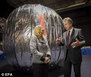 NASA Deputy Administrator Lori Garver and President and founder of Bigelow Aerospace Robert T. Bigelow in front of what could become one of the first space hotel rooms