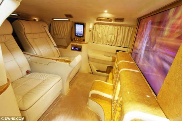 Pass the popcorn: The car relies on a driver as the divider between the back and front has been turned into a widescreen television and champagne bar