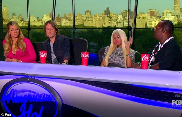 Stuck in the middle: Fellow judges Keith Urban and Randy Jackson patiently sat back as the pair had it out