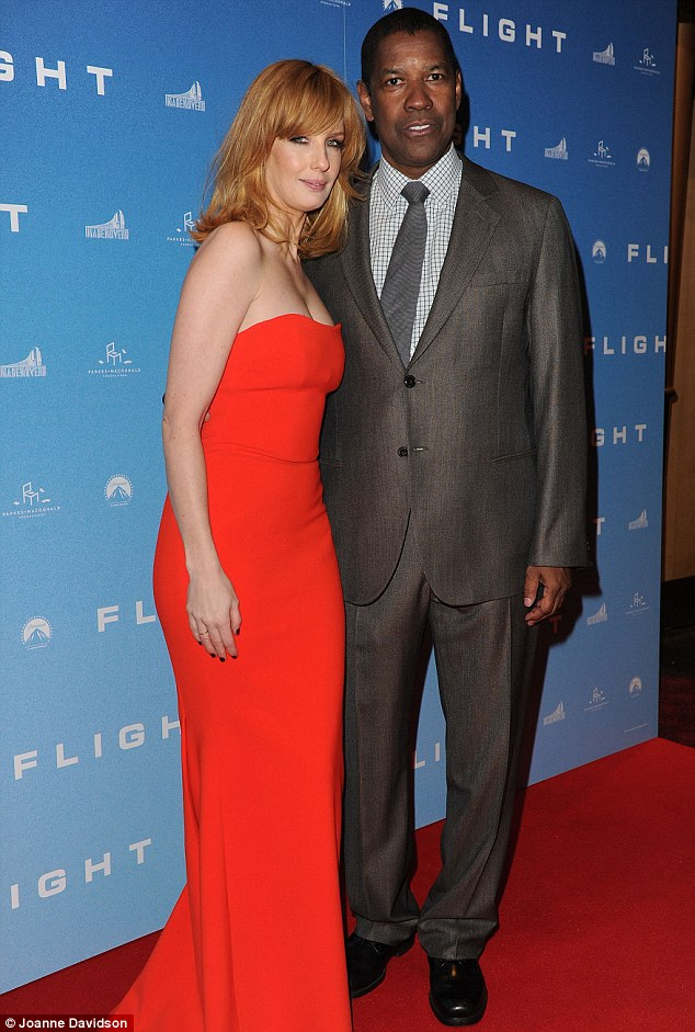 Oscar hopeful: Kelly joins her Flight leading man Denzel Washington - who is up for Best Actor