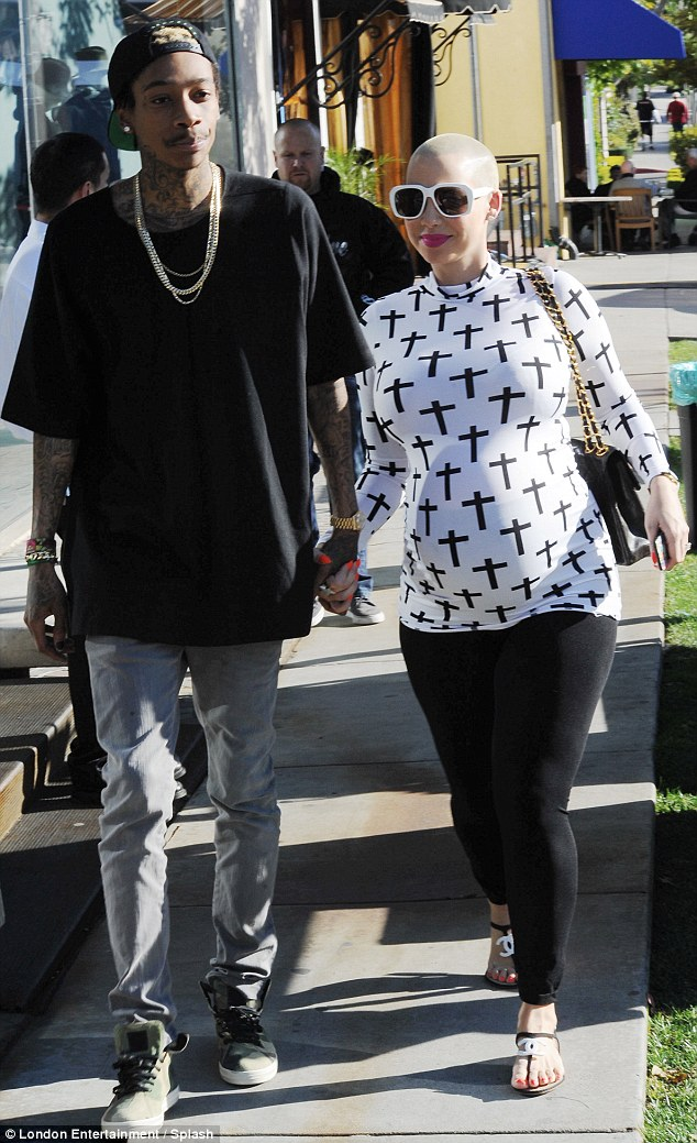 Hand-in-hand: Amber Rose and fiance Wiz Khalifa shopped in Beverly Hilla, California on Thursday