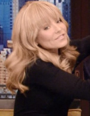 Trendsetter: Paying homage to the First Lady's birthday haircut, Kelly Ripa, co-host of the morning talk show Live! with Kelly and Michael, debuted her own set of clip-on bangs this morning