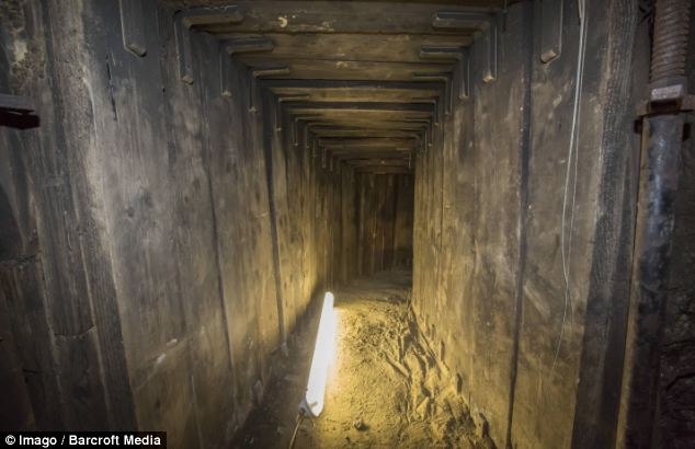 The tunnel, nearly 4.5ft high and 3ft wide, was supported by wooden shoring to prevent it collapsing. Police believe the perpetrators removed rubble and their spoils at night