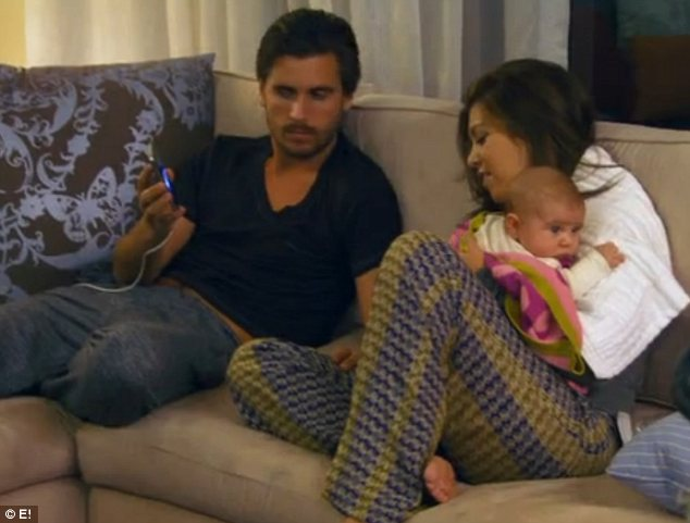 Family time: Scott was relaxing on the sofa with Kourntey while she tended to their baby Penelope