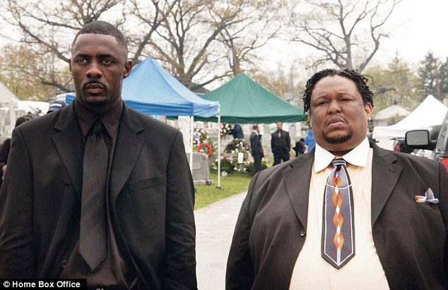 Success: Chew, pictured on the right with actor Idris Elba, left, on The Wire, stayed on for the entire five-season run of the hit HBO show