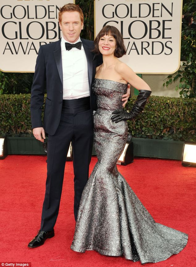 Actor Damian Lewis (left) and Helen McCrory arrive at the 69th Annual Golden Globe Awards in Beverly Hills, California