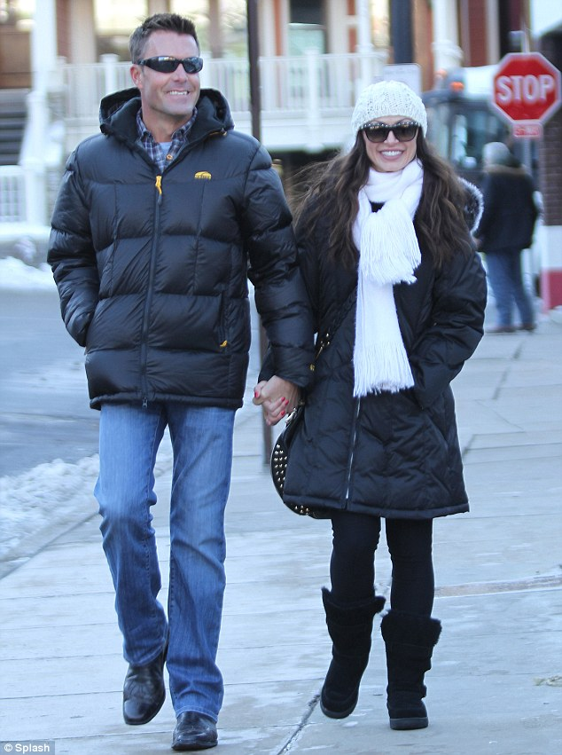 Snow bunny: The 35-year-old dancer was all smiles as she enjoyed an evening stroll down Kings Drive with a mystery man