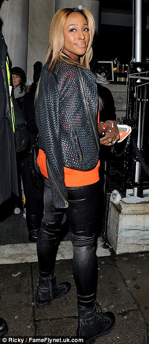 Biker babe: Alexandra wore a pair of biker boots with her tight trousers and a leather jacket over her shoulders