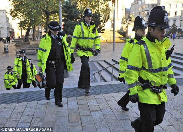 Employed: John Dwyer said that officers, such as these working in Liverpool, were fortunate to have jobs, despite plans to cut starting salaries. File picture