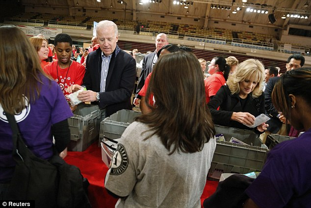 Volunteers: Vice President Joe Biden, pictured, his wife, Jill, and others members of his family spent the morning filling care packages for U.S. troops serving overseas, veterans and first responders