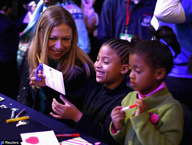 Having fun: Chelsea Clinton, left, makes cards with children during a National Day of Service event on the National Mall in Washington D.C. today