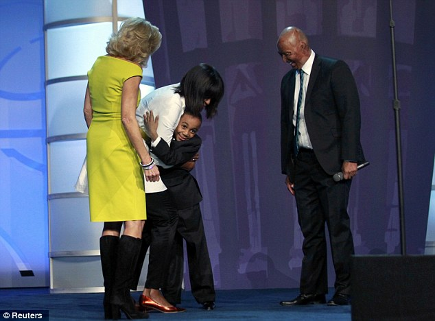 Embrace: Franco got a big hug from the first lady on stage during the gala