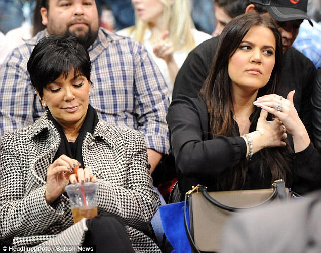 Not really there: Khloe and Kris seemed like they wished to be anywhere but at the Staples Centre