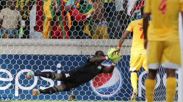 Zambia's keeper Kennedy Mweene dives to save a penalty kick from Ethiopia's Saladin Said