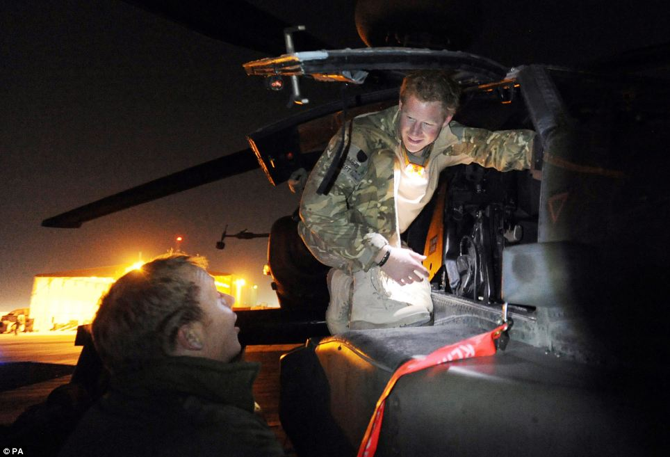 Prince Harry inspects his Apache helicopter before lifting off on a night mission from his base in southern Afghanistan