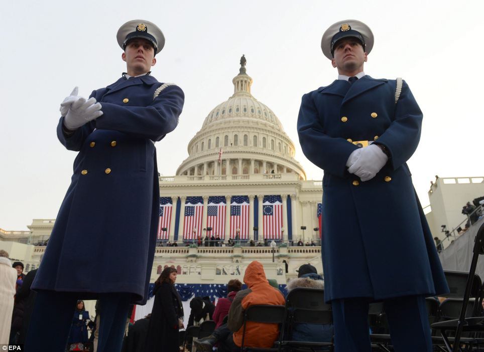 Preparation: US navy sailors stand at the West Front of the US Capitol hours before the ceremony