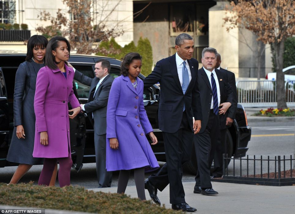 First family: The Obamas were all smiles as they arrived at the church ahead of the inauguration