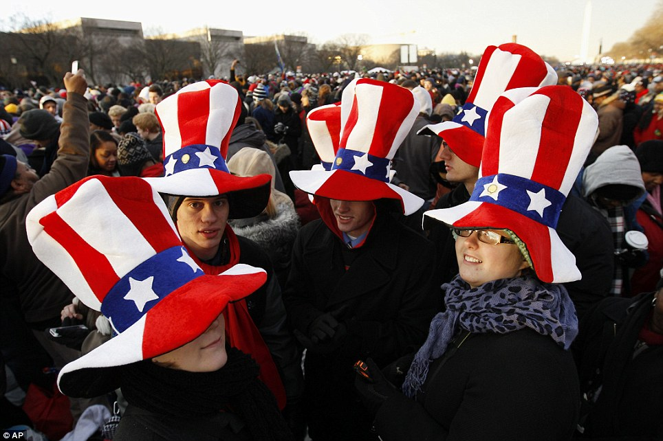 Patriotic: Obama supporters wait on the National Mall for the start of the ceremonial swearing in on Monday morning