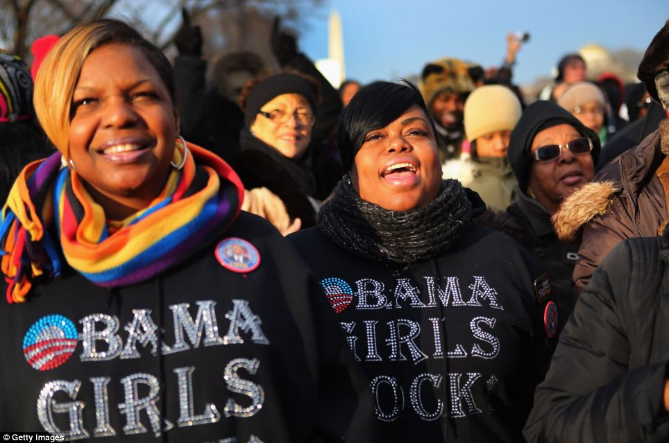 Fans: Rickita Glass (left) and Kelly Grimes and others gather near the U.S. Capitol building on the National Mall for the Inauguration ceremony