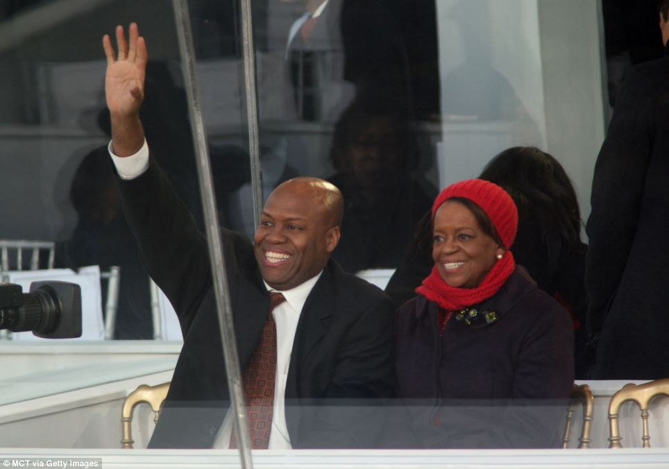Family: Michelle Obama's brother Craig Robinson, head coach of Oregon State, left, and their mother Marian Robinson watch the Inaugural Parade