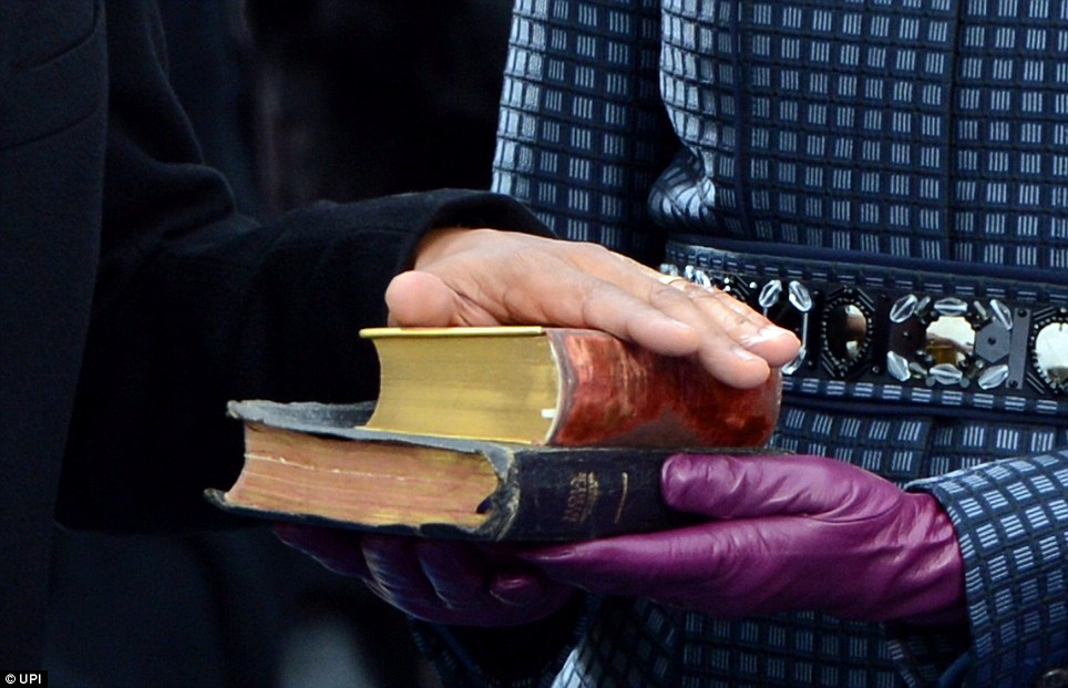 Keeping the faith: Barack Obama is sworn in as President on two Bibles - one belonging to Abraham Lincoln and the 'traveling Bible' of Martin Luther King