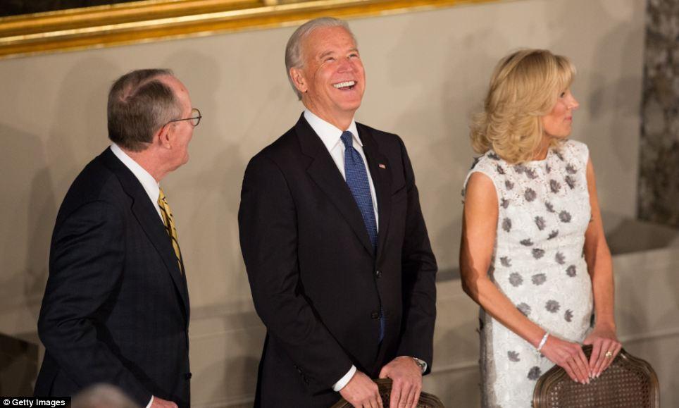 Good humoured: Vice President Biden shares a joke with Senator Lamar Alexander as his wife Dr. Jill Biden stands to his left