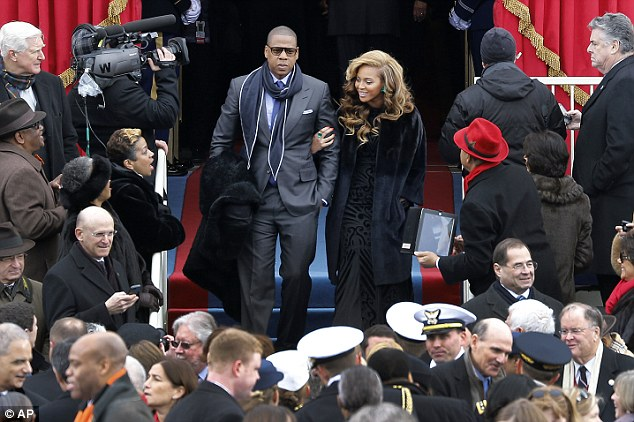 Quite an entrance: The power couple received a cheer from the crowd as they walked in