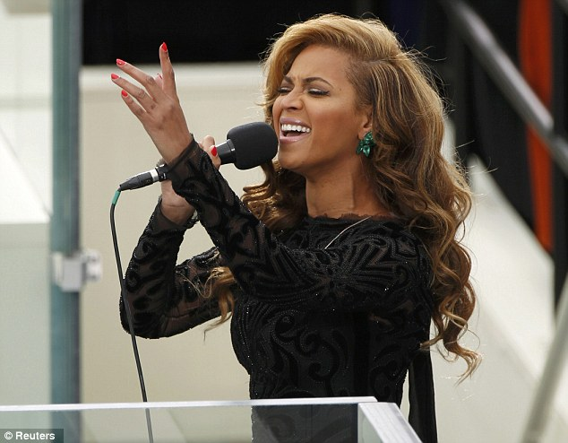 Perfect choice: Beyonce looked emotional as she took to the podium, but showed no sign of nerves
