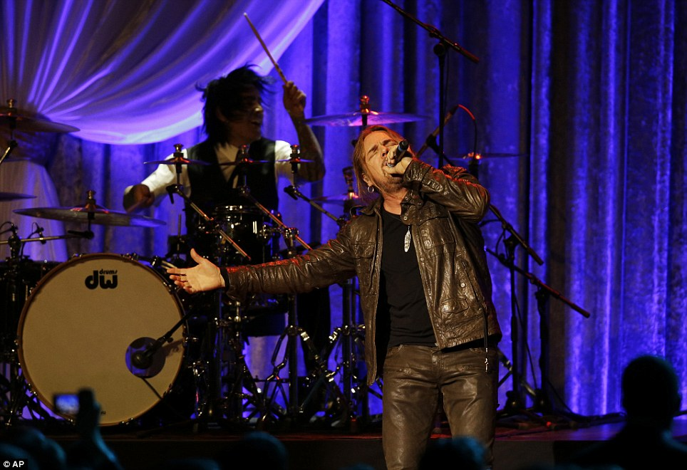 Rocking out: The Mexican pop rock band Mana performs during the Inaugural Ball