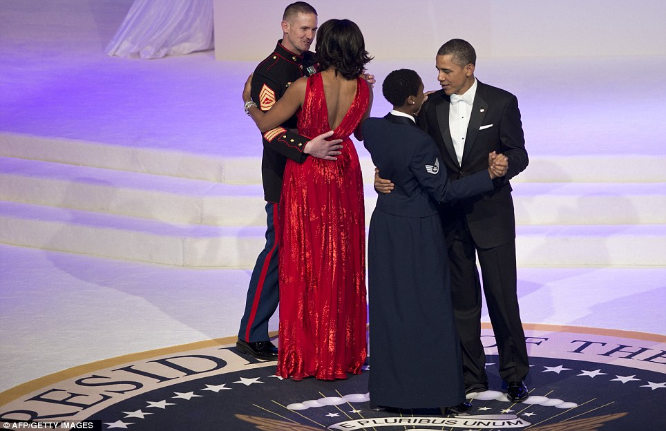 Honored: Barack and Michelle dance with service members during the ball to celebrate his second term