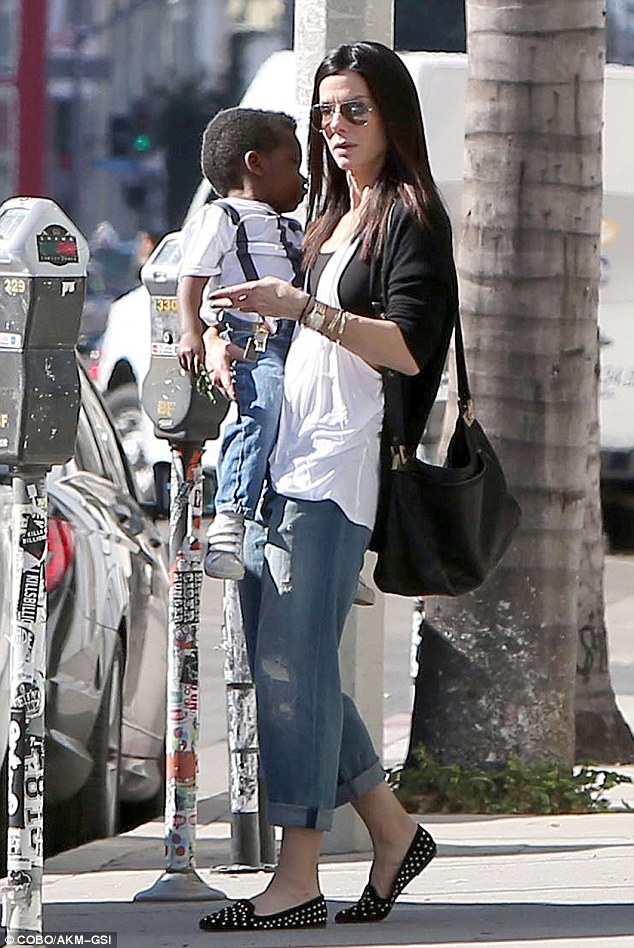 Casual day: Sandra and Louis were dressed in lookalike outfits including white tees and blue jeans
