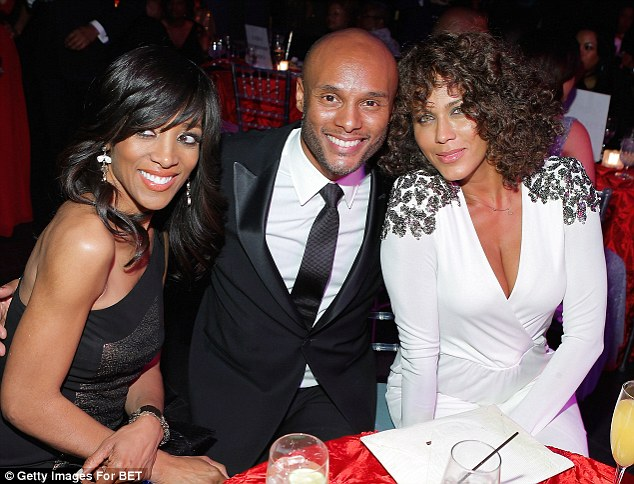 Cuddling up: Actor Boris Kodjoe cuddled up to Robinson and actress and model Nicole Ari Parker for a snap