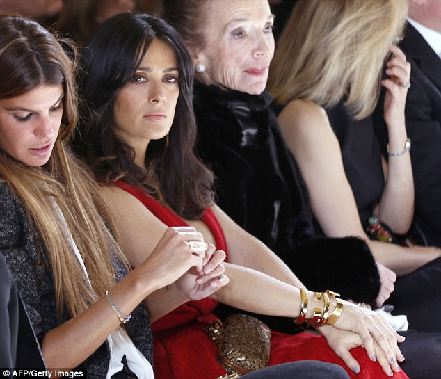 Fashion fan: Salma sits in between Italian actress Bianca Brandolini and Princess Lee Radziwill on the front row
