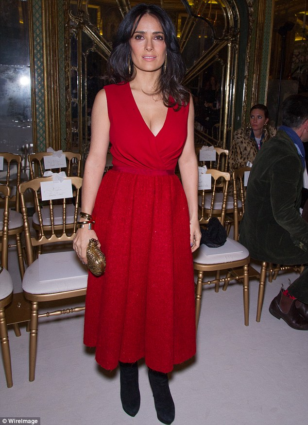 Lady in red: Salma Hayek wears a plunging red dress to the Giambattista Valli Spring/Summer 2013 Haute-Couture show in Paris