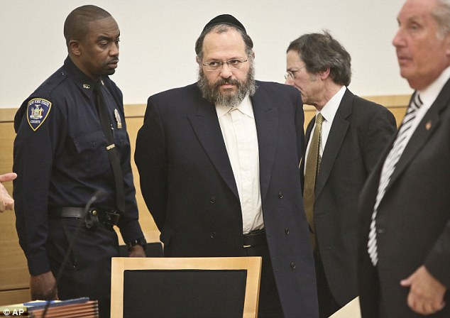 Sentenced: Nechemya Weberman, seen entering a Brooklyn courtroom on Tuesday, centre, was sentenced to 103-years in prison for molesting a young girl over the course of several years