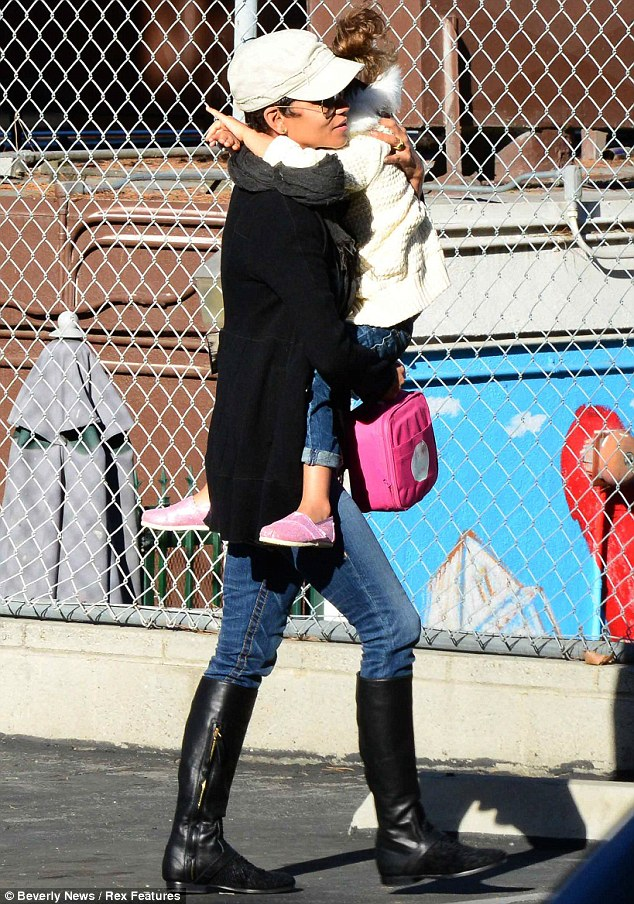 Walking tall: At one point Halle picked up her toddler daughter as they headed back to the car