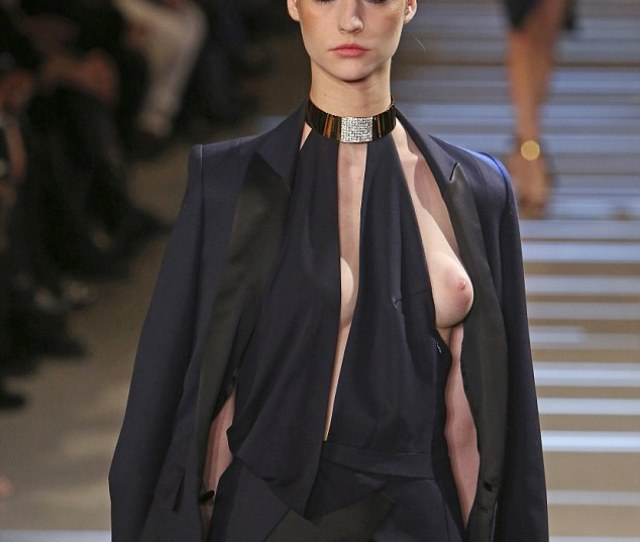 Not A Wardrobe Malfunction The Material Of The Short Black Dress Is Deliberately Cut Away