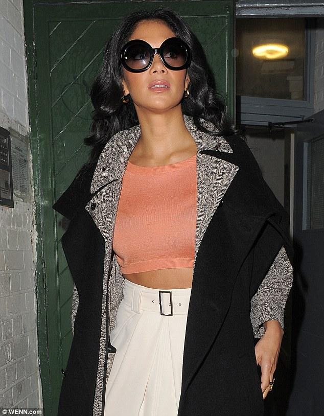Toned tummy: Earlier in the day, Nicole had displayed her washboard abs in a cropped top and white high-waisted skirt