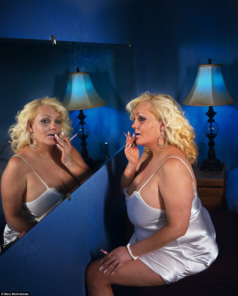 Waiting: Simone at Donna's Ranch in Battle Mountain, Nevada, is seen here primping herself before the day's customers arrive. Photographer Marc McAndrews often worked in the morning and afternoon, before the brothels opened or when there were few customers