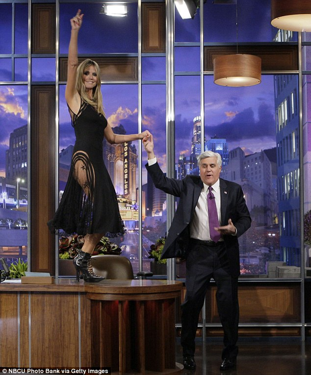 Dancing on tables like Paris Hilton in 2003: Heidi Klum danced atop Jay Leno's desk while wearing an ultra-sheer LBD during her appearance on The Tonight Show Wednesday