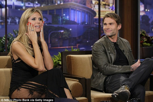 Flashing her thigh: The German supermodel appeared on Leno alongside a very pleased-looking Seann William Scott, who was plugging Movie 43