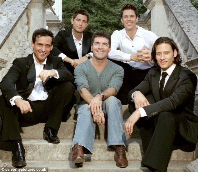 Sound of success: Simon Cowell surrounded by Il Divo, (from left) Carlos Marin, Sebastien Izambard, David Miller and Urs Buhler