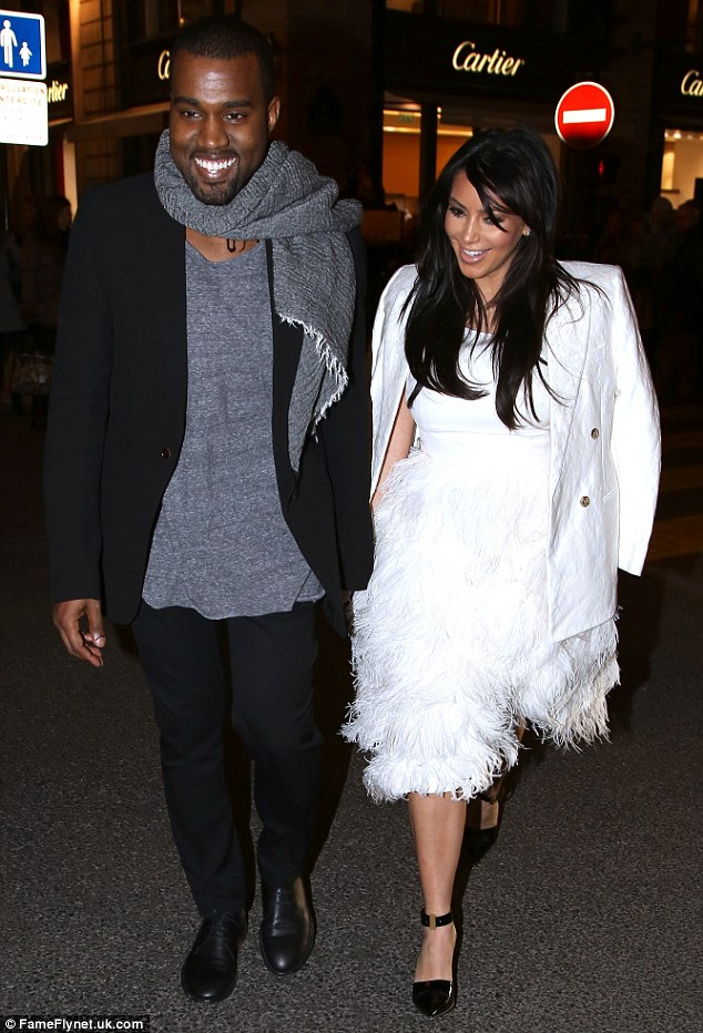 Hand-in-hand: The couple looked smitten as they strolled the streets hand-in-hand