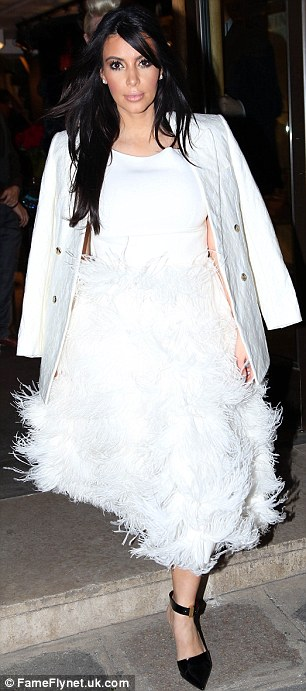 Standing out: It was hard to miss Kim in her all-white outrageous outfit