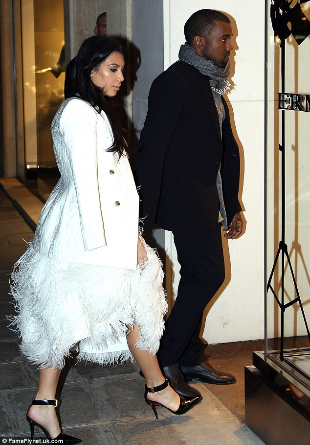 Aren't you cold? Kim paired the ball gown-style dress with a cream linen jacket which, despite being chilly in the French capital, she opted to drape over her shoulders