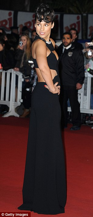 Glamorous night: Alicia Keys was also in attendance, showing off her style in a floorlength black gown with revealing cut out detailing