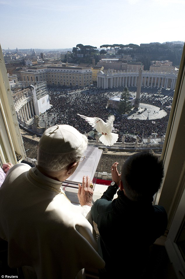 Message of hope: A boy (right) releases the dove of peace next to Pope Benedict XVI during the Angelus prayer in Saint Peter's square at the Vatican